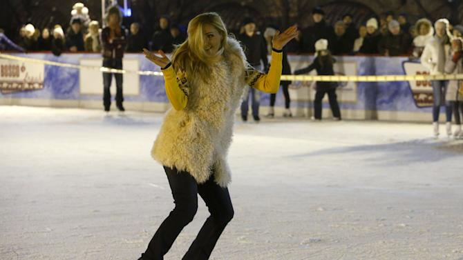 Russian ice dancer Navka performs at ice rink on its first day of operation in front of GUM department store in Moscow's Red Square