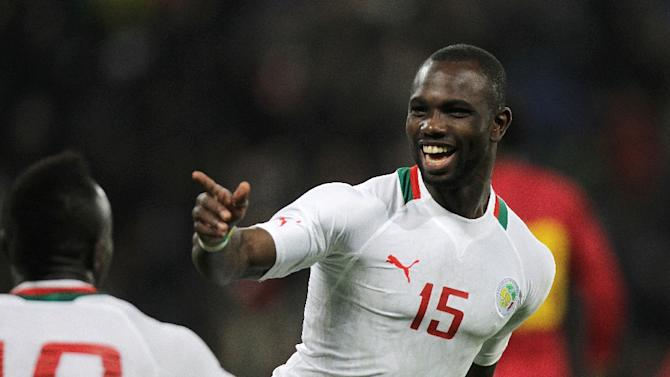 Senegal's Moussa Konate celebrates after scoring a goal during the International Friendly football match between Senegal and Ghana on March 28, 2015 in Le Havre, northwestern France
