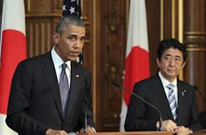 U.S. President Barack Obama attends a news conference with Japanese Prime Minister Shinzo Abe at the Akasaka guesthouse in Tokyo
