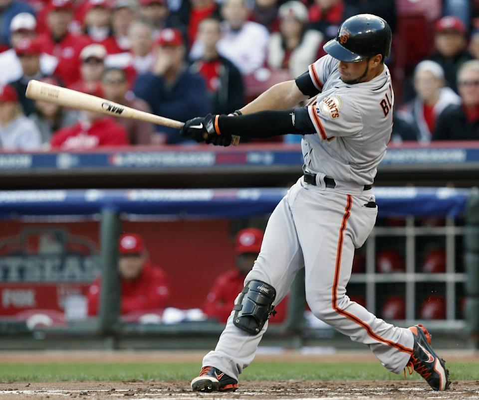San Francisco Giants' Gregor Blanco hits a two-run home run off Cincinnati Reds starting pitcher Mike Leake in the second inning of Game 4 of the National League division baseball series, Wednesday, Oct. 10, 2012, in Cincinnati. (AP Photo/David Kohl)