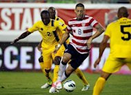Clint Dempsey (2nd R) of the US during the 2014 World Cup qualifying match against Antigua and Barbuda on June 8. Dempsey and Carlos Bocanegra scored first-half goals as the US beat Antigua and Barbuda 3-1