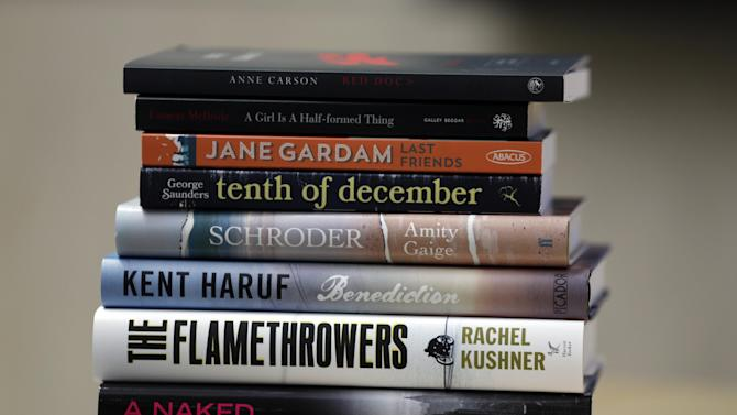 """Copies of the books whose authors are finalists for the Folio Prize,are pictured during a photo call following a news conference, in central London, Monday, Feb. 10, 2014. The 40,000 British pound (some 66,000 US dollars) Folio Prize is open to any work of fiction published in UK in 2013. The eight finalists of the literary prize announced Monday, include five books by U.S. writers: """"Schroder"""" by Amity Gaige; """"Benediction"""" by Kent Haruf; """"The Flamethrowers"""" by Rachel Kushner; """"A Naked Singularity"""" by Sergio De La Pava; and """"Tenth of December"""" by George Saunders. There is also Canadian Anne Carson's """"Red Doc"""" and two books by Britain-based writers — Jane Gardam's """"Last Friends,"""" and Eimear McBride's """"A Girl is a Half-Formed thing"""". The winner will be announced March 10, 2014 in London.(AP Photo/Lefteris Pitarakis)"""