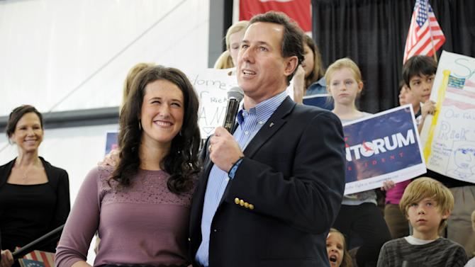 Republican presidential candidate, former Pennsylvania Sen. Rick Santorum introduces his daughter Elizabeth while campaigning at the Peachtree DeKalb Airport, Thursday, March 1 , 2012, in Chamblee, Ga. (AP Photo/John Amis)