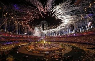 The Olympic cauldron is lit during the Opening Ceremony at the 2012 Summer Olympics, Saturday, July 28, 2012, in London. (AP Photo/Paul Sancya)