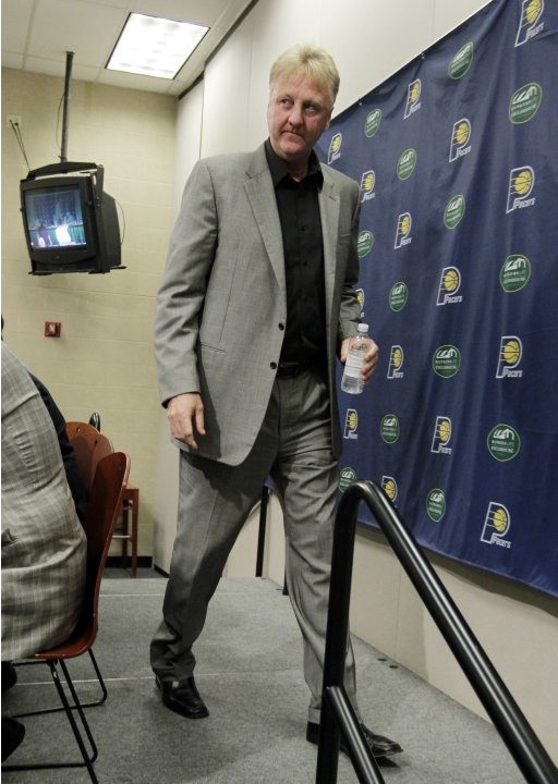 Larry Bird leaves the stage after announcing that he is stepping down as president of the Indiana Pacers at a news conference by the NBA basketball team in Indianapolis, Wednesday, June 27, 2012. Donn
