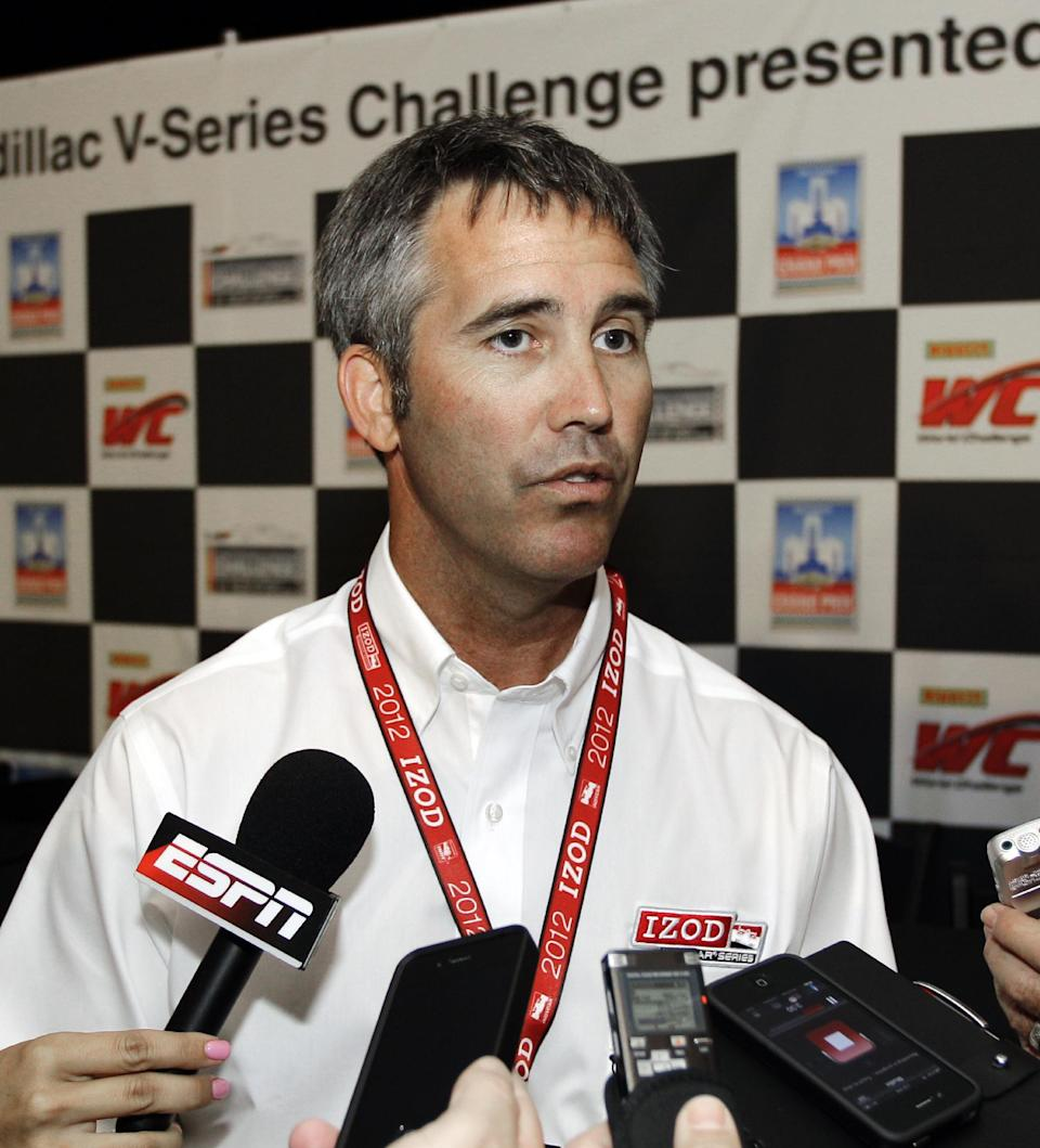 IndyCar CEO Randy Bernard addresses reporters before the Detroit Grand Prix auto race on Belle Isle in Detroit, Sunday, June 3, 2012. (AP Photo/Carlos Osorio)