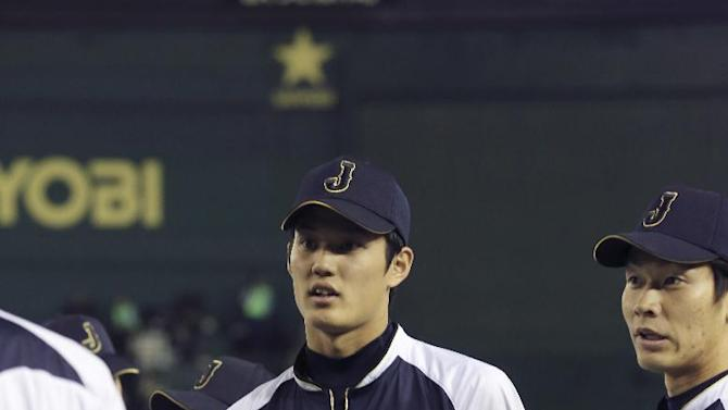 Japan's pitcher Shintaro Fujinami works out before their exhibition baseball game against the Major League All-Stars at Tokyo Dome in Tokyo, Friday, Nov. 14, 2014. (AP Photo/Koji Sasahara)