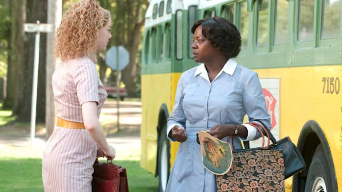 """In this film publicity image released by Disney, from left, Emma Stone and Viola Davis are shown in a scene from """"The Help.""""  The declining DVD business has forced Hollywood to rethink what it's willing to pay to make a blockbuster.  While Hollywood's newfound cost-consciousness doesn't herald the coming of sock-puppet cinema, belt-tightening could favor more character-driven productions such as """"The Help,"""" which struck box office gold with sales of $97 million so far, despite a cost of just $25 million to make. (AP Photo/Disney, Dale Robinette)"""
