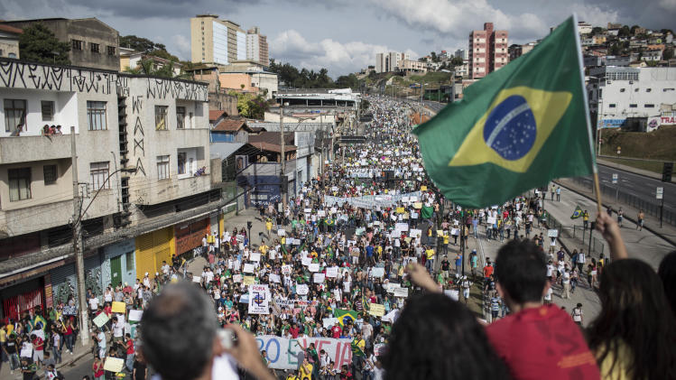 People march toward the Mineirao stadium during a protest in Belo Horizonte, Brazil, Saturday, June 22, 2013. Demonstrators once again took to the streets in Brazil on Saturday, continuing a wave of protests that have shaken the nation and pushed the government to promise a crackdown on corruption and greater spending on social services. (AP Photo/Felipe Dana)