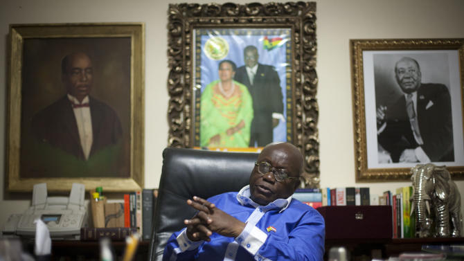 Opposition presidential candidate Nana Akufo-Addo of the New Patriotic Party sits in his office the evening before presidential elections, in Accra, Ghana, Thursday, Dec. 6, 2012. The scion of an important political family, Akufo-Addo sits beneath portraits of his father Edward Akufo-Addo, right, a Chief Justice and former President of Ghana, and his great uncle J.B. Danquah, left, who worked for the independence of Ghana from Colonial power Britain. Ghanaians go to the polls Friday to choose between four candidates including President John Dramani Mahama, who inherited the top post in July after the death of president John Atta Mills, and Akufo-Addo, who lost the presidency by less than 1 percent to Mills in 2008. (AP Photo/Gabriela Barnuevo)