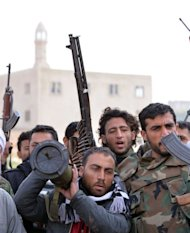 <p>Rebel fighters prepare to fight against Syrian regime forces in the village of Kurnaz, close to the western city of Hama, on January 27, 2013. The United Nations says more than 60,000 people have been killed since the start of the conflict in March 2011.</p>