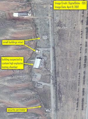 """In this  image released by ISIS, satellite imagery of the Parchin site is seen from April 9, 2012, taken before the beginning of major alterations undergone by the site starting in late spring of 2012. The original security perimeter and driveways to the various buildings are clearly visible as are the two small buildings that were later demolished. International officials engaged in a two-pronged effort Wednesday Dec. 12 2012 to engage Iran over concerns the country may have worked on nuclear weapons, with a U.N. team seeking access to a site linked to such suspected activity and European Union negotiators looking to restart talks with Tehran meant to ease such fears.   Emailing a series of commercial satellite photographs to The Associated Press Wednesday, the Institute for Science and International Security said the images showed """"a steady pace of what appears to be the """"reconstruction"""" phase of the site which between April and July 2012 had undergone considerable alterations. (AP Photo/ Isis)"""