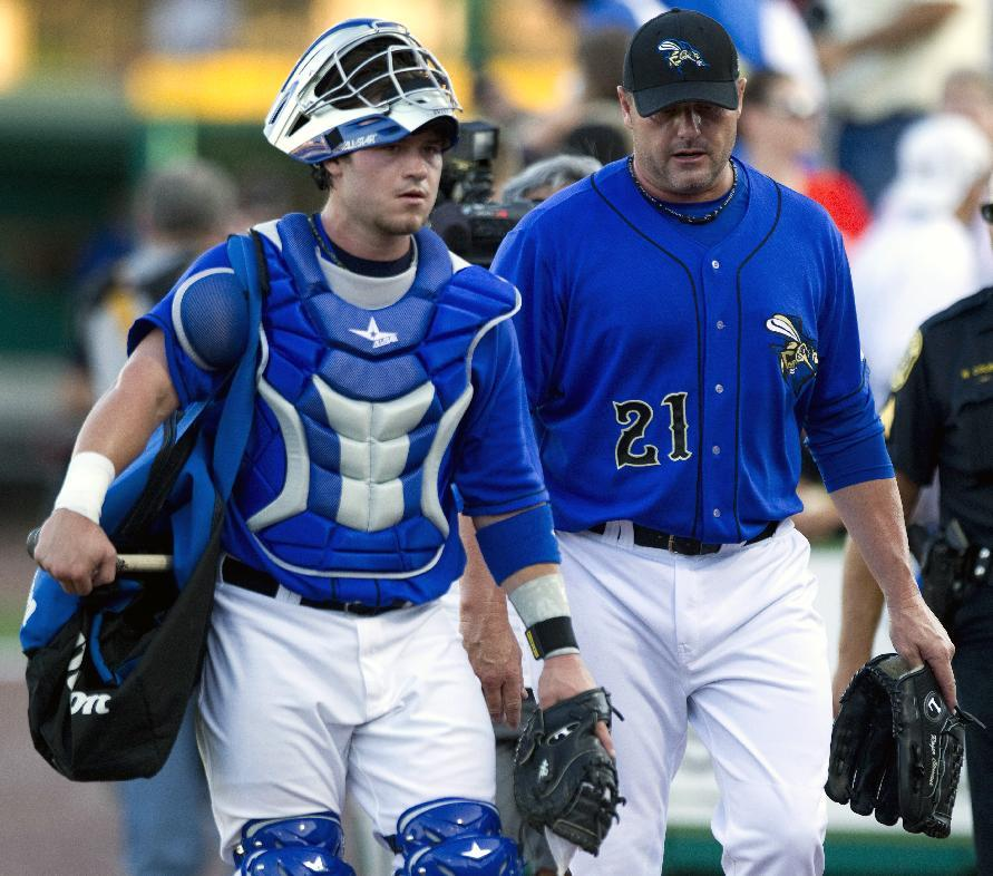 Sugar Land Skeeters catcher Koby Clemens, left, and his father, starting pitcher Roger Clemens, walk in from the bullpen before a minor league baseball game against the Long Island Ducks at Constellation Field Friday, Sept. 7, 2012, in Sugar Land, Texas.  (AP Photo/Houston Chronicle, Brett Coomer)  MANDATORY CREDIT
