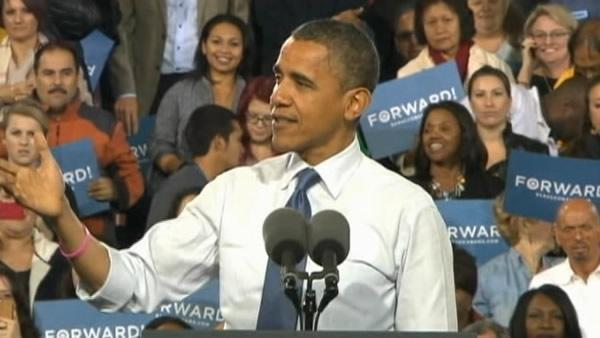 Obama campaigns as storm charges towards battlegrounds