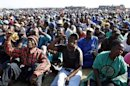 The mining community reacts as they are addressed by their leaders during a strike at Lonmin's Marikana platinum mine in Rustenburg