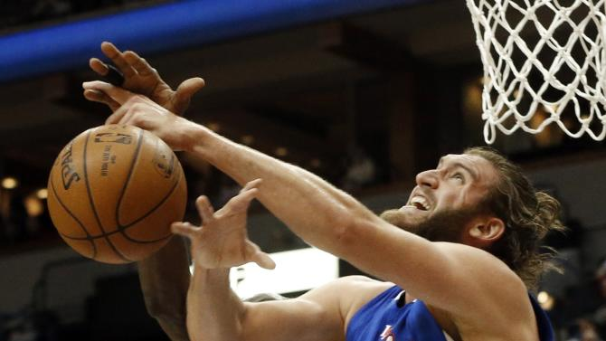 Los Angeles Clippers' Spencer Hawes, right, has the ball knocked away by Minnesota Timberwolves' Kevin Garnett during the second half of an NBA basketball game, Monday, March 2, 2015, in Minneapolis. The Clippers won 110-105. (AP Photo/Jim Mone)