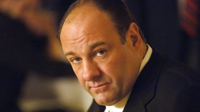 """FILE - This undated publicity photo, released by HBO, shows actor James Gandolfini in his role as Tony Soprano, head of the New Jersey crime family portrayed in HBO's """"The Sopranos."""" HBO and the managers for Gandolfini say the actor died Wednesday, June 19, 2013, in Italy. He was 51. (AP Photo/HBO, Barry Wetcher, File)"""