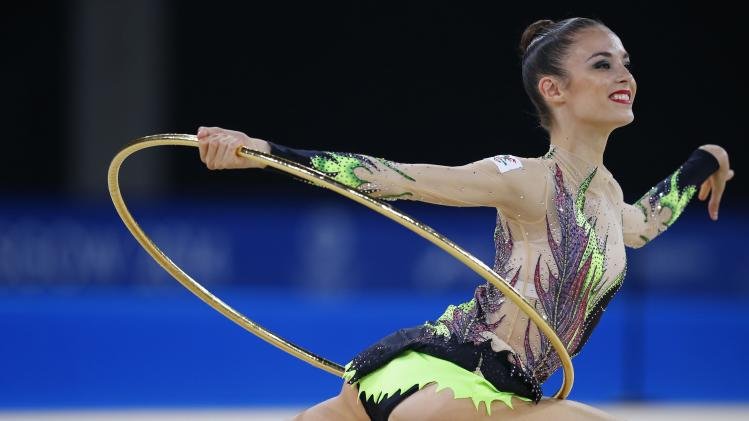 Halford of Wales performsduring her hoop routine as she competes in the rhythmic Gymnastics individual all-around final at the 2014 Commonwealth Games in Glasgow,