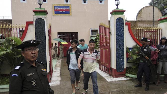 Chinese nationals, who were jailed for illegal logging, walk out of Myitkyina prison after being released during an amnesty in Myitkyina