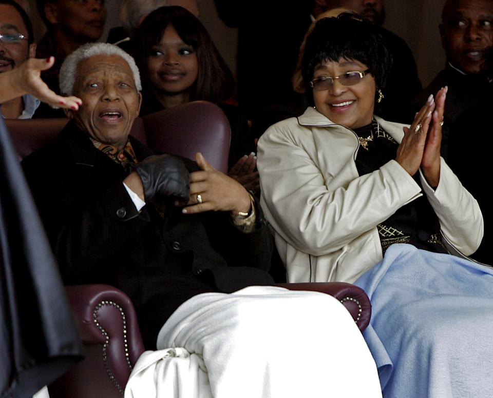 """FILE - In this Thursday, Aug. 21, 2008 file photo former president Nelson Mandela, left, and his ex-wife Winnie Madikizela-Mandela, right, during the unveiling of a statue of Mandela at the Drakenstein Prison near Franschhoek, South Africa. Madikizela-Mandela told a South African newspaper published Sunday Nov. 17, 2013, that Mandela, remains """"quite ill"""" and unable to speak because of tubes that are keeping his lungs clear of fluid, though he is relaxed. (AP Photo/Schalk van Zuydam-File)"""