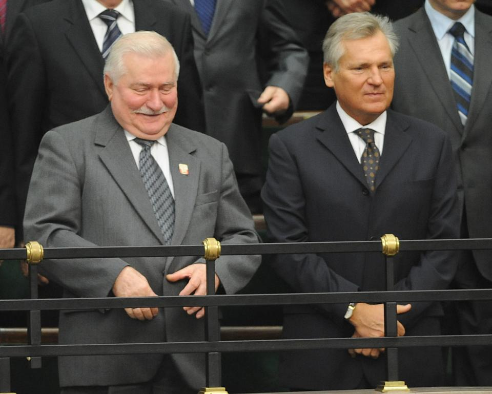 Former Polish presidents, Lech Walesa, left, and Aleksander Kwasniewski watch from the balcony during the first session of the new Polish Parliament, in Warsaw, Poland, Tuesday, Nov. 8, 2011. (AP Photo/Alik Keplicz)