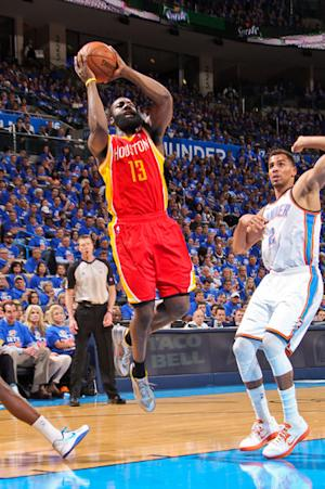 Harden powers past illness, lifts Rockets 107-100