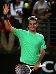 ROME, ITALY - MAY 18:  Roger Federer of Switzerland plays waves to the crowd after his straight sets victory against Benoit Paire of France in their semi final match during day seven of the Internazionali BNL d&#39;Italia 2013 at the Foro Italico Tennis Centre  on May 18, 2013 in Rome, Italy.  (Photo by Clive Brunskill/Getty Images)