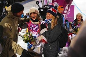 Gold medalist Kaitlyn Farrington of the U.S. celebrates with her parents Gary and Suze Farrington after winning the women's snowboard halfpipe at the 2014 Sochi Winter Olympic Games in Rosa Khutor
