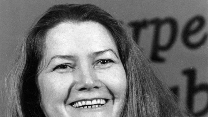 """FILE - In this March 1, 1977 file photo, Australian author Colleen McCullough laughs during a news conference in New York. Australia's largest newspaper was facing sharp criticism over its obituary of the nation's most famous author, whom the paper described as plain and overweight. The Australian newspaper's obituary of Colleen McCullough, whose novel """"The Thorn Birds"""" sold 30 million copies worldwide and who died on Thursday, Jan. 29, 2015 at age 77 after a long illness, opened not with a list of her myriad accomplishments, but with a description of her appearance. (AP Photo/File)"""