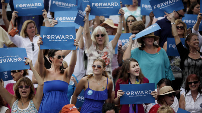 Spectators cheer as President Barack Obama addresses the crowd at a rally at St. Petersburg College's Seminole Campus on Saturday, Sept. 8, 2012 in St Petersburg, Fla. (AP Photo/The Tampa Bay Times, Will Vragovic, Pool)