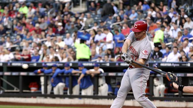 Cincinnati Reds' Jay Bruce hits an RBI double during the first inning of the baseball game against the New York Mets at Citi Field Monday, May 20, 2013 in New York. (AP Photo/Seth Wenig)