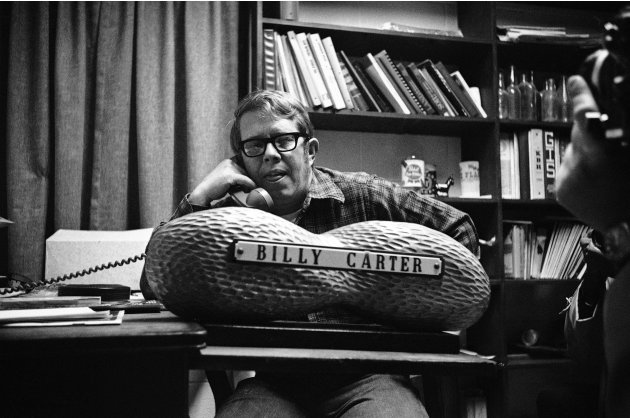 FILE - In this Jan. 18, 1977, file photo, Billy Carter, younger brother of President elect Jimmy Carter, spends most of the day on the phone telling friends that he doesn't have any more tickets to an