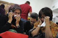 Relatives of passengers on the crashed Russian Sukhoi Superjet 100 cry at Halim Perdanakusuma airport in Jakarta on May 10, 2012. All of the dozens aboard a Russian Sukhoi passenger jet flying on a sales promotion trip in Indonesia were killed when the plane slammed into a mountain, officials said on Thursday