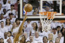 Miami Heat center Hassan Whiteside (21) goes to the basket against the Charlotte Hornets in the first half of Game 7 of a first-round NBA basketball playoff series, Sunday, May 1, 2016, in Miami. (AP Photo/Alan Diaz)