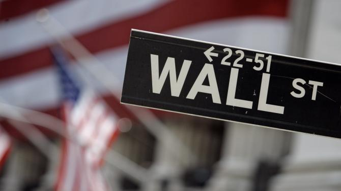 FILE - This May 11, 2007, file photo shows a Wall Street sign near the flag-draped facade of the New York Stock Exchange. Stronger earnings from several U.S. companies are sending stock prices higher in early trading Wednesday, May 6, 2015. (AP Photo/Richard Drew, File)