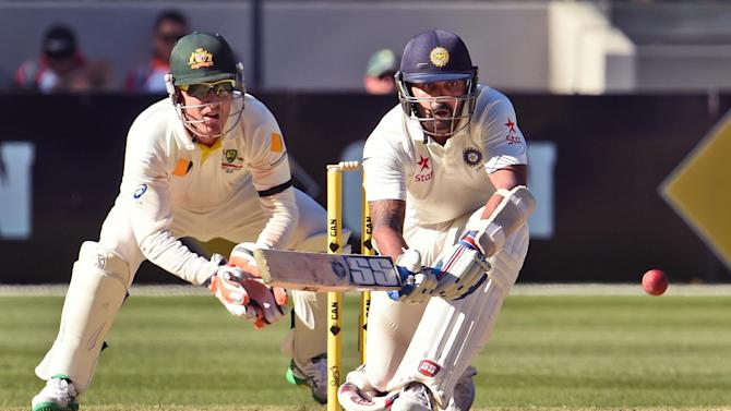 Indian batsman Murali Vijay (R) prepares to sweep as Australian wicketkeeper Brad Haddin (L) keeps watch on the second day of the third cricket Test played at the Melbourne Cricket Ground (MCG) on December 27, 2014