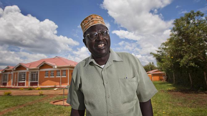FILE - In this Sunday, Nov. 4, 2012 file photo, Malik Obama, half-brother of President Barack Obama, poses for photographs after speaking about the then upcoming U.S. elections to an Associated Press television reporter in the village of Kogelo where he lives in western Kenya. Malik Obama is running for governor in the country's nationwide elections to be held on Monday, March 4, 2013, saying in a phone interview Friday, March 1, 2013 that he can't run away from his name and association with the U.S. President. (AP Photo/Ben Curtis, File)