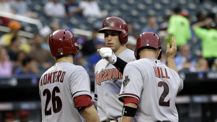 Arizona Diamondbacks' Paul Goldschmidt, center, is greeted by Miguel Montero, left, and Aaron Hill after hitting a two-run homer during the first inning of the baseball game against the New York Mets at Citi Field, Monday, July 1, 2013, in New York. (AP Photo/Seth Wenig)