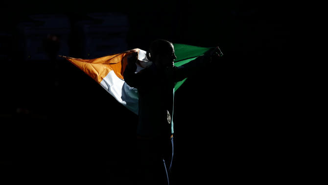Gold medallist Katie Taylor of Ireland carries her country's flag during the presentation ceremony for the Women's Light (60kg) boxing competition at the London Olympic Games