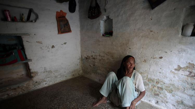 """In this May 10, 2012 photo, Fatima Munshi sits in her home in Khandwa, India. One day in 1987, Munshi's 5-year-old son, Saroo, was still curled up on the hard wooden seat of the Indian train, just as he was when he'd drifted to sleep. The rattle of the train was loud and steady, just as it always was when he rode with his big brother, Guddu. But Guddu wasn't there, and the landscape flashing past the window looked nothing like home. He was alone in the world. So began an accidental new life that would take him first to the desperate streets of Calcutta, then to a government center for abandoned children, and finally to an adoptive family - in far-off Australia. As he thrived there, he never forgot his home in a poor Indian town whose name he couldn't remember. And his memory burned with thoughts of his mother, who searched in vain for him but believed a fortuneteller's promise that they'd meet again. (AP Photo/Saurabh Das) PART OF A SERIES OF PHOTOS FOR """"LONGEST JOURNEY HOME"""" PART 1"""