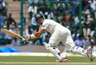New Zealand captain Ross Taylor hits a boundary during the third day of the second Test match between India and New Zealand at the M. Chinnaswamy Stadium in Bangalore. Indian off-spinner Ravichandran Ashwin bagged five wickets to throw the second and final Test against New Zealand wide open on the third day in Bangalore