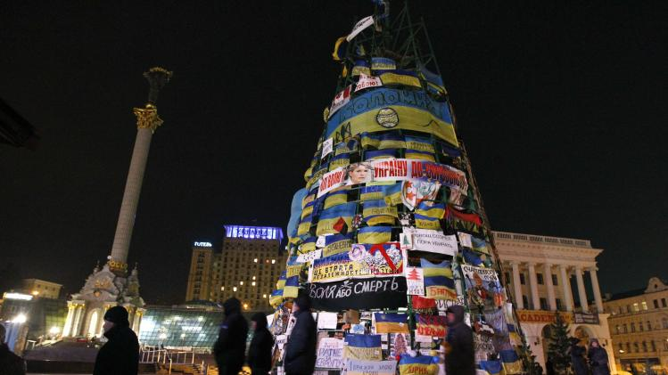Opposition signs, placards and flags are seen on an artificial Christmas Tree during a pro-EU protest in Kiev