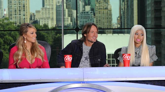 """FILE - ThisSept. 17, 2012 file image released by Fox shows the new judges for the singing competition series, """"American Idol,"""" from left, Mariah Carey, Keith Urban and Nicki Minaj and during a news conference in New York. Host Ryan Seacrest said Wednesday, Oct. 3, that things got intense between new judges Nicki Minaj and Mariah Carey during a tryout taping in Charlotte, N.C., the day before. In the midst of a dispute over a contestant, Minaj announced that she was no longer putting up with """"her ... highness,"""" a reference to Carey with a few expletives added in. Another new judge, Keith Urban, was in the unenviable position of sitting between them. (AP Photo/FOX, Michael Becker)"""