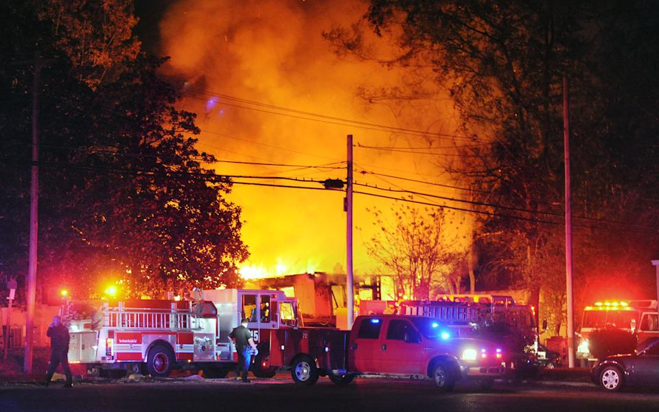 Flames and smoke billow from a home in west Jackson, Miss., Tuesday evening, Nov. 13, 2012, after authorities say a small plane carrying three people crashed into the residence shortly after 5 p.m.  (AP Photo/The Clarion-Ledger, Joe Ellis)  NO SALES