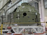 The orbital flight-model Orion capsule pictured here will have to be repaired before its flight on a Delta 4 rocket in 2014. A crack formed in its aft bulkhead during recent pressure testing at Kennedy Space Center in Florida.