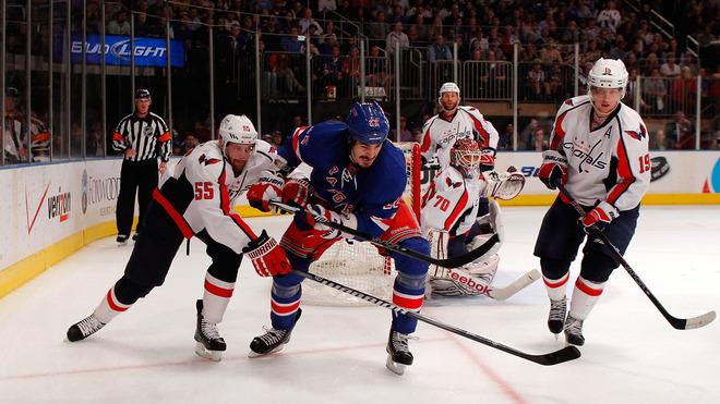 Brian Boyle #22 Of The New York Rangers Fights For The Puck In The Corner In The Secon Dperiod Against Jeff Halpern # Getty Images