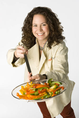 FILE-   In this file image released by Bravo, chef Stephanie Izard is shown. In the year since it opened, Girl and the Goat, Izard's Chicago restaurant, already has been nominated for a James Beard award and won accolades from critics across the country.    (AP Photo/Bravo, Chuck Hodes, FILE)
