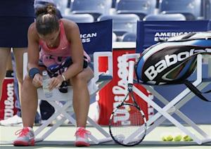 Errani of Italy sits during a break in play against compatriot Pennetta at the U.S. Open tennis championships in New York