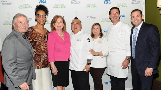 """IMAGE DISTRIBUTED FOR CHASE SAPPHIRE PREFERRED - From left, Taste America honorary chair, chef Jacques Pepin, chef Carla Hall, James Beard Foundation president Susan Ungaro, chef Tory Miller, chef Maricel Presilla, chef Michael Anthony and Director of Marketing for Chase Sapphire Preferred, Jeff Bedard, pose together at the kick-off event for the James Beard Foundation's """"Taste America"""" traveling food festival presented by Chase Sapphire Preferred Visa Signature at the James Beard House on Wednesday, June 12, 2013 in New York City, New York. (Photo by Evan Agostini/Invision for Chase Sapphire Preferred/AP Images)"""