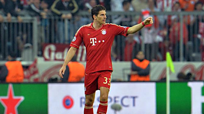 Bayern's Mario Gomez celebrates after scoring during the Champions League semifinal first leg soccer match between Bayern Munich and FC Barcelona in Munich, Germany, Tuesday, April 23, 2013. (AP Photo/Kerstin Joensson)